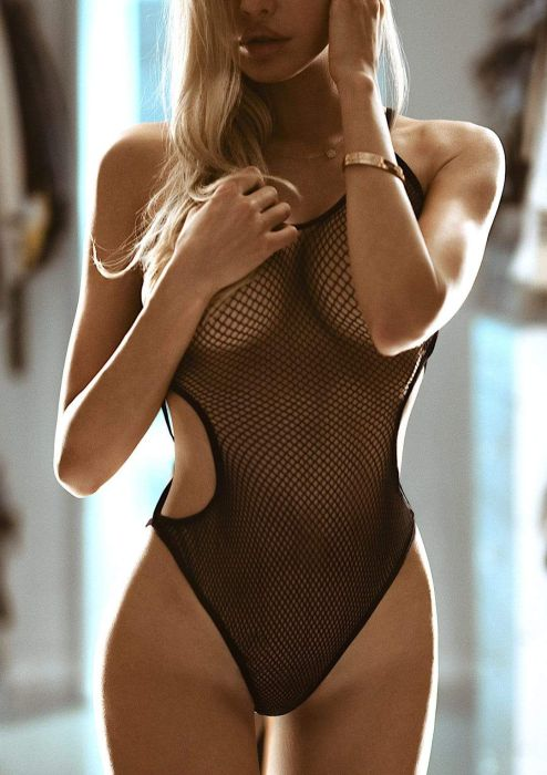 Leg Avenue Fishnet teddy with nearly naked strappy back